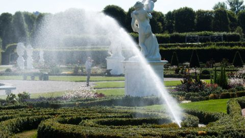 04 July 2018, Germany, Hanover:Lawn sprinklers water the green areas at the Herrenhausen Gardens. The gardeners fight against the persistent drought. Two million litres of water are being scattered on the beds, plants and green areas at the baroque garden every day. Photo: Julian Stratenschulte/dpa
