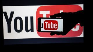 The logo of Youtube is seen on two screens. The accounts of the extreme right and conspiracy theory portal Infowars have been banned from several social networks and even Youporn. Infowars is one of the media, that supports US-President Donald Trump most. The media was founded by Alex Jones. (Photo by Alexander Pohl/NurPhoto)