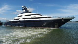 The Cayman Island-registered vessel Equanimity, which is reportedly worth some 250 million USD and is owned by Jho Low, a former unofficial adviser to the Malaysian fund 1MDB, is pictured at Benoa harbour on Indonesia's resort island of Bali on April 13, 2018. Indonesian police on February 28 boarded and searched the luxury vessel Equanimity which was being sought by US investigators as part of their probe into Malaysian state fund 1MDB. / AFP PHOTO / SONNY TUMBELAKA