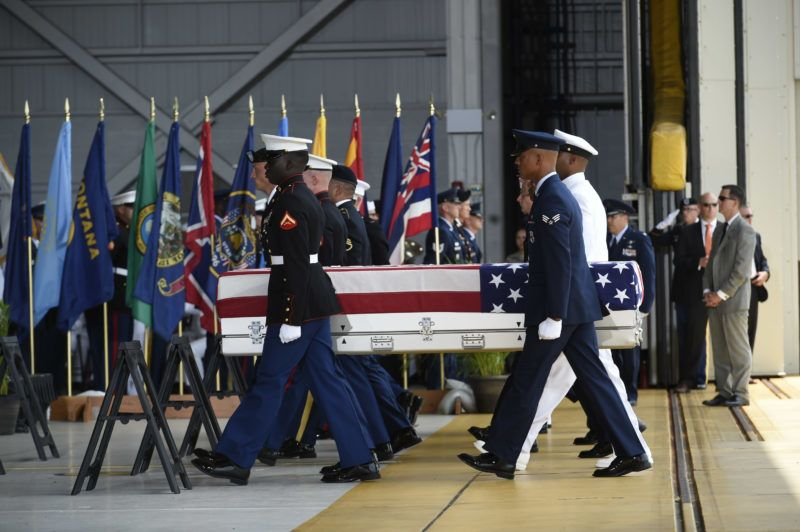 Military pallbearers carry the believed to be remains of U.S. service members collected in the Democratic People's Republic of Korea during Repatriation ceremony after arriving to Joint Base Pearl Harbor-Hickam, Honolulu, Hawaii, on August 1, 2018.     Sixty-five years after the Korean War ended, the remains of dozens of American soldiers killed during the brutal conflict are finally coming home. Wednesday's repatriation marks an important step after US President Donald Trump and North Korean leader Kim Jong Un held a summit, during which Kim agreed to send home the war dead.  / AFP PHOTO / Ronen Zilberman