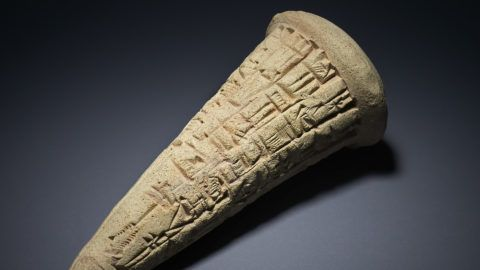 """A handout picture released by the British Museum in London on August 9, 2018 shows a Sumerian clay cone, dating to around 2200BC, bearing a cuneiform inscription, identical to inscribed cones found on the site of the Eninnu temple in the ancient city of Girsu, now known as Tello, in southern Iraq, that were looted and confiscated by British police in May 2003.   The British Museum said on August 9, 2018 it is returning to Iraq a collection of looted antiquities dating back up to 5,000 years, after identifying the exact temple they came from in a unique piece of archaeological detective work. / AFP PHOTO / The British Museum / - / RESTRICTED TO EDITORIAL USE - MANDATORY CREDIT """"AFP PHOTO / BRITISH MUSEUM """" - NO MARKETING NO ADVERTISING CAMPAIGNS - DISTRIBUTED AS A SERVICE TO CLIENTS"""