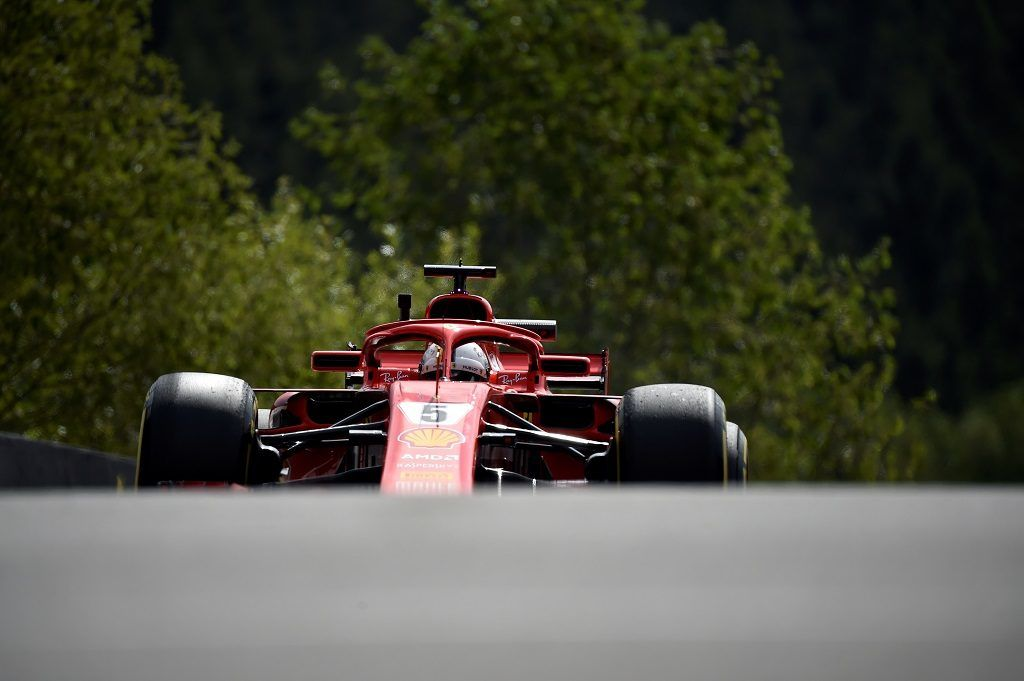 Ferrari's German driver Sebastian Vettel drives during the first practice session at the Spa-Francorchamps circuit in Spa on August 24, 2018 ahead of the Belgian Formula One Grand Prix. / AFP PHOTO / JOHN THYS
