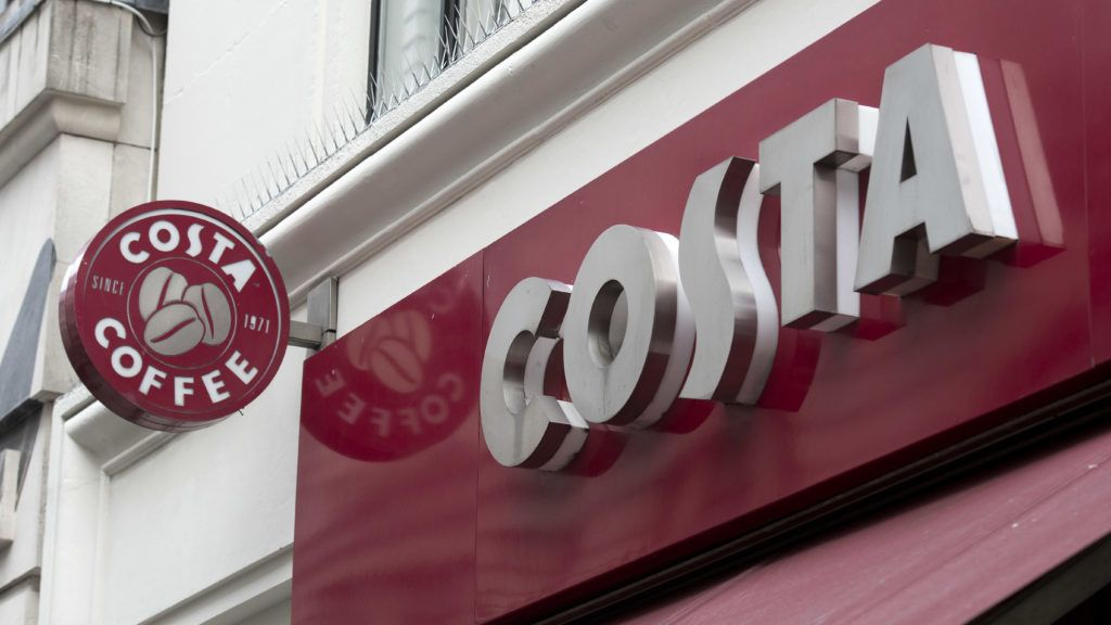 (FILES) In this file photo taken on November 15, 2017 the Costa coffee logo is pictured above a Costa coffee shop in London.   Coca-Cola on August 31, 2018 said it had agreed to buy global coffee chain Costa from its owner Whitbread for £3.9 billion ($5.1 billion). / AFP PHOTO / Justin TALLIS