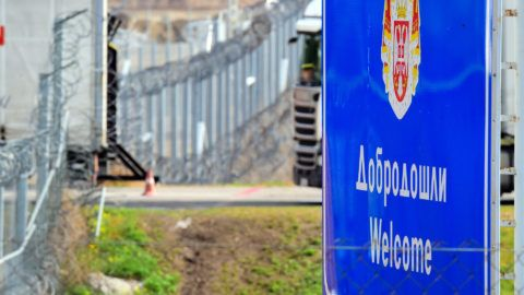 A signs welcomes people in English and Serbian languages at the Hungarian border fence at the Tompa border station transit zone on April 6, 2017 as the Hungarian Interior Minister Sandor Pinter (not pictured) presents the camp to the media.   The migrant transit complex on the Hungarian side of the border has been expanded to become one of two new detention centers for asylum seekers in the Hungarian transit zone and contains shipping containers that are used to automatically detain migrants in the transit zone while their claims are investigated.   / AFP PHOTO / ATTILA KISBENEDEK