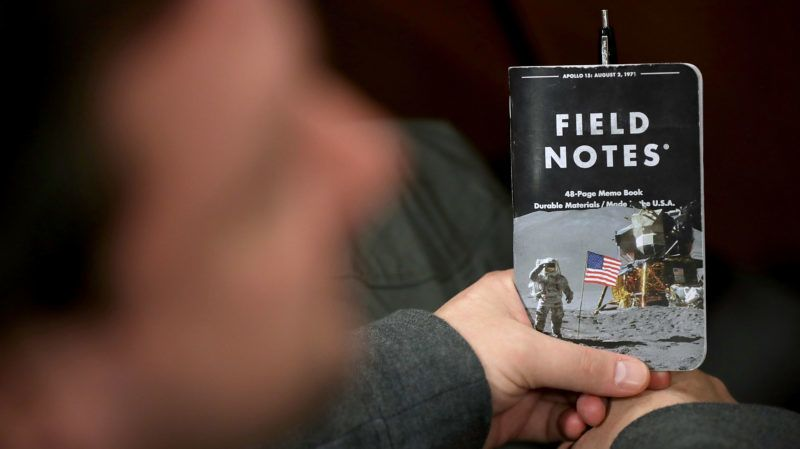 ARLINGTON, VA - AUGUST 09: An attendee holds a space-themed notebook before a speech by U.S. Vice President Mike Pence to announce the Trump Administration's plan to create the U.S. Space Force by 2020 at the Pentagon August 9, 2018 in Arlington, Virginia. Describing space as adversarial and crowded and citing threats from China and Russia, Pence said the new Space Force would be a separate, sixth branch of the military.   Chip Somodevilla/Getty Images/AFP