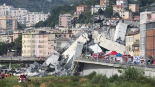 The remains of the Morandi motorway bridge stands after it partially collapsed in Genoa, Italy, on Tuesday, Aug. 14, 2018. The famous bridge of highway A10 that connected the Liguria region with south Italy collapsed with many victims. (Photo by Mauro Ujetto/NurPhoto)