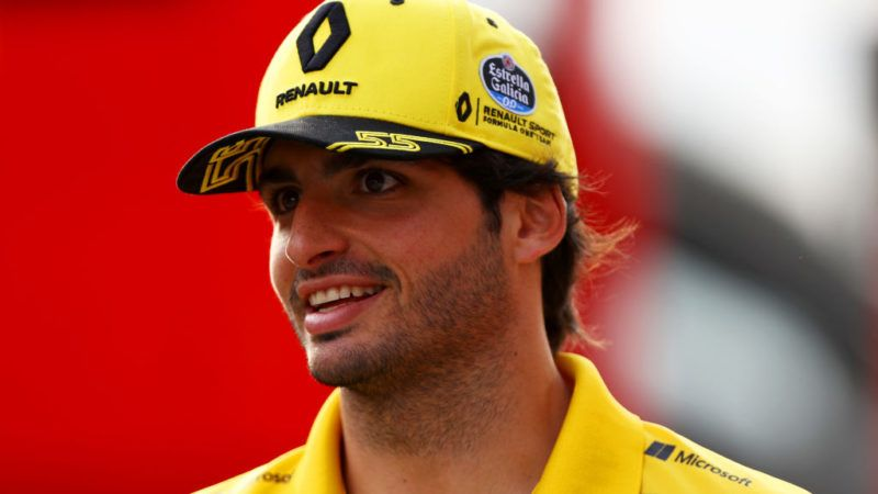 BUDAPEST, HUNGARY - JULY 27: Carlos Sainz of Spain and Renault Sport F1 walks in the Paddock after practice for the Formula One Grand Prix of Hungary at Hungaroring on July 27, 2018 in Budapest, Hungary.  (Photo by Dan Istitene/Getty Images)