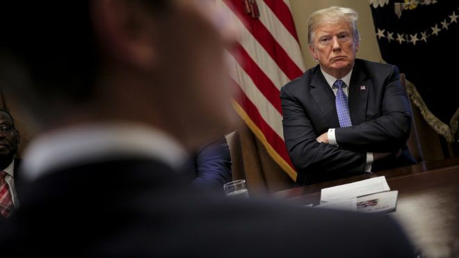 WASHINGTON, DC - AUGUST 01: (AFP OUT) U.S. President Donald Trump listens during a meeting with inner city pastors in the Cabinet Room of the White House on August 1, 2018 in Washington, DC. (Photo by Oliver Contreras - Pool/Getty Images)
