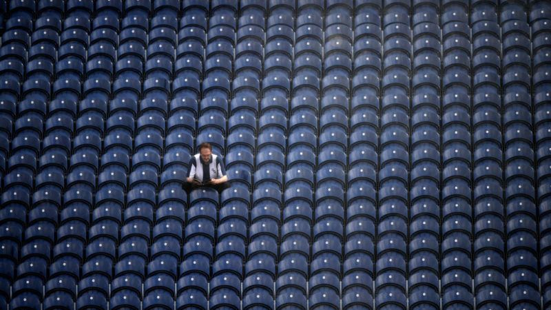 WEST BROMWICH, ENGLAND - AUGUST 04:  A lone West Brom fan reads his programme prior to the Sky Bet Championship match between West Bromwich Albion and Bolton Wanderers at The Hawthorns on August 4, 2018 in West Bromwich, England.  (Photo by Laurence Griffiths/Getty Images)