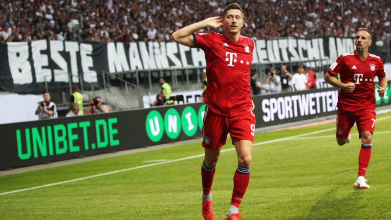 FRANKFURT AM MAIN, GERMANY - AUGUST 12:  Robert Lewandowski of Bayern Munich celebrates after scoring the first goal during the DFL Supercup 2018 match between Eintracht Frankfurt and Bayern Muenchen at Commerzbank-Arena on August 12, 2018 in Frankfurt am Main, Germany.  (Photo by Adam Pretty/Bongarts/Getty Images)
