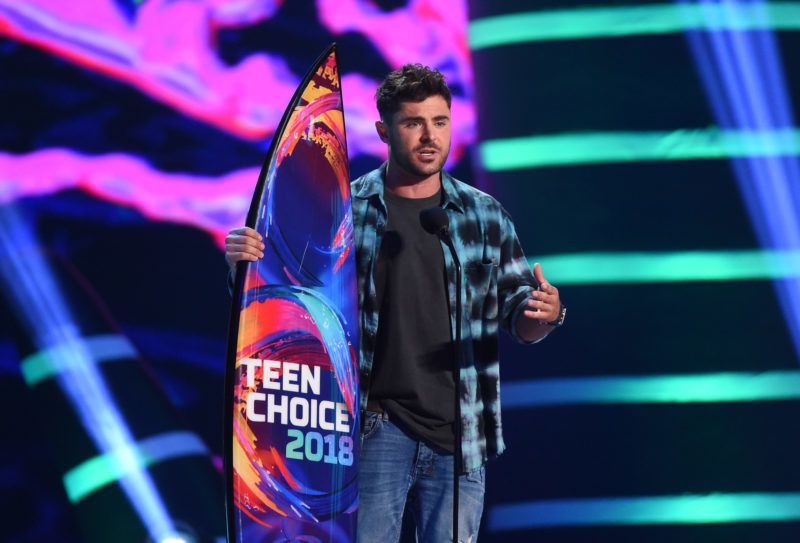 """INGLEWOOD, CA - AUGUST 12:  Zac Efron accepts the Choice Drama Movie Actor award for """"The Greatest Showman"""" onstage during FOX's Teen Choice Awards at The Forum on August 12, 2018 in Inglewood, California.  (Photo by Kevin Winter/Getty Images)"""