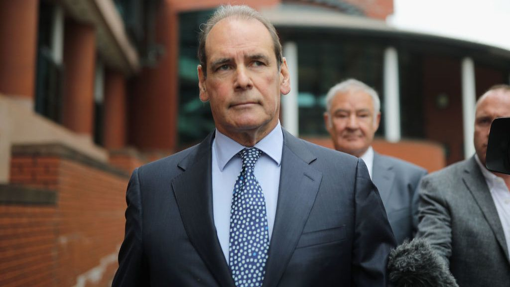 PRESTON, ENGLAND - AUGUST 21:  Sir Norman Bettison leaves Preston Crown Court after he was granted a stay of proceedings during a hearing on August 21, 2018 in Preston, England. Former South Yorkshire Police Chief Inspector Sir Norman Bettison, 62, had been charged with four counts of misconduct in a public office relating to alleged lies he told about his role in the aftermath of the Hillsborough disaster, in which 96 Liverpool fans died. The prosecution has now been discontinued due to insufficient evidence.  (Photo by Christopher Furlong/Getty Images)