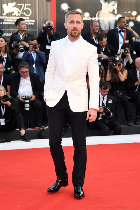 VENICE, ITALY - AUGUST 29:  Ryan Gosling walks the red carpet ahead of the opening ceremony and the 'First Man' screening during the 75th Venice Film Festival at Sala Grande on August 29, 2018 in Venice, Italy.  (Photo by Daniele Venturelli/Daniele Venturelli/WireImage)