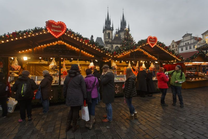 PRAGUE, CZECH REPUBLIC - NOVEMBER 30:  People shop in a Christmas market at the Old Town Square on November 30, 2014 in Prague, Czech Republic. Christmas markets, traditionally selling mulled wine, roasted chestnuts, hot mead, and christmas tree decorations amongst other products opened across the Czech Republic during the first Advent weekend.  (Photo by Matej Divizna/Getty Images)
