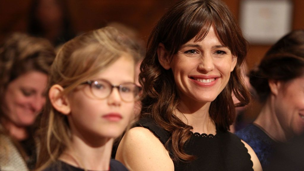 """WASHINGTON, DC - MARCH 26:  Actress Jennifer Garner (R) and her daughter Violet Affleck listen to Ben Affleck testify before a Senate Appropriations State, Foreign Operations, and Related Programs Subcommittee hearing on """"Diplomacy, Development, and National Security"""" on Capitol Hill in Washington March 26, 2015.  (Photo by Paul Morigi/WireImage)"""