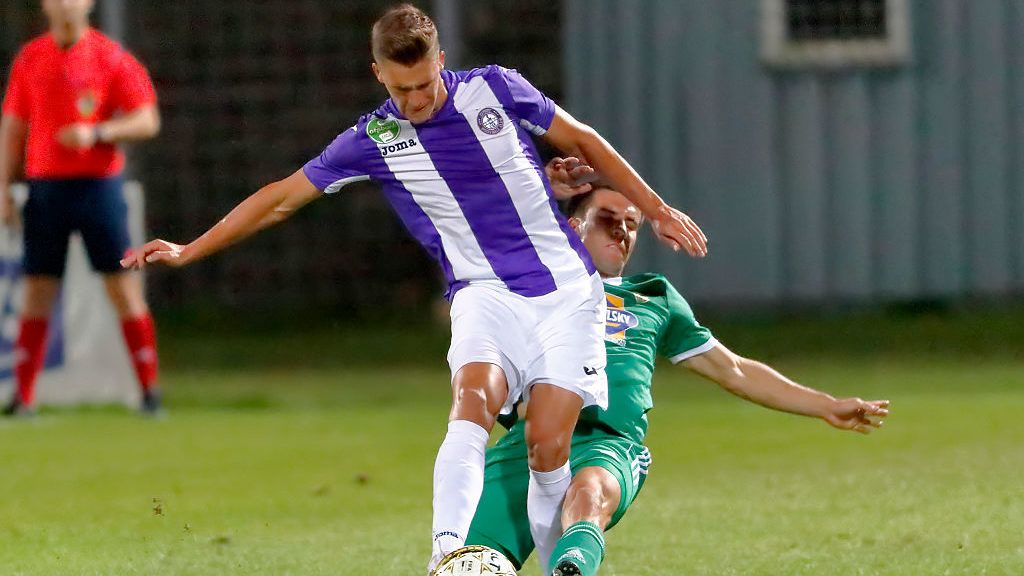 BUDAPEST, HUNGARY - SEPTEMBER 21: Zsolt Angyal (R) of Swietelsky Haladas fouls Jozsef Windecker (L) of Ujpest FC during the Hungarian OTP Bank Liga match between Ujpest FC and Swietelsky Haladas at Illovszky Stadium on September 21, 2016 in Budapest, Hungary. (Photo by Laszlo Szirtesi/Getty Images)