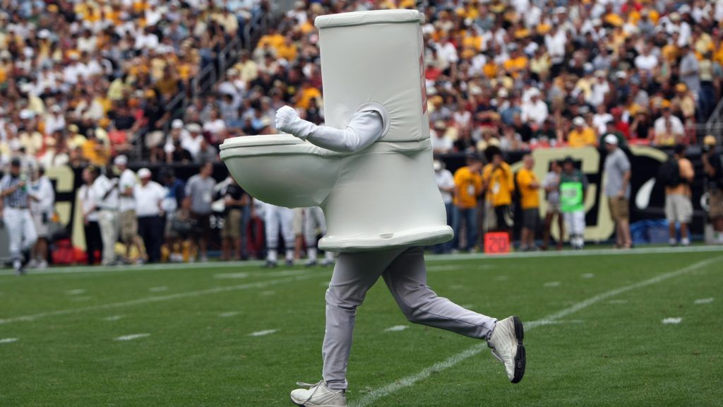 DENVER - SEPTEMBER 1:  A man dressed as a toilet runs on the field during the Colorado State Rams game against the Colorado Buffaloes at INVESCO Field at Mile High on September 1, 2007 in Denver, Colorado. Colorado won 31-28 in overtime. (Photo by Doug Pensinger/Getty Images)