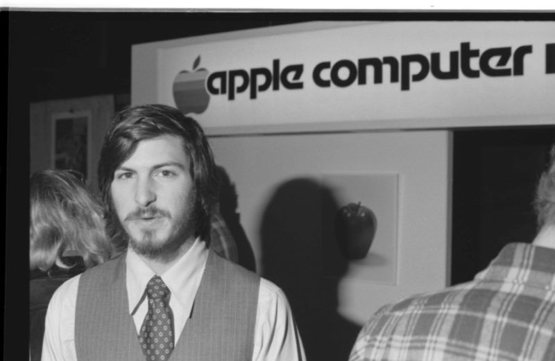 Portrait of American businessman and engineer Steve Jobs, co-founder of Apple Computer Inc, at the first West Coast Computer Faire, where the Apple II computer was debuted, in Brooks Hall, San Francisco, California, April 16th or 17th, 1977. (Photo by Tom Munnecke/Getty Images)