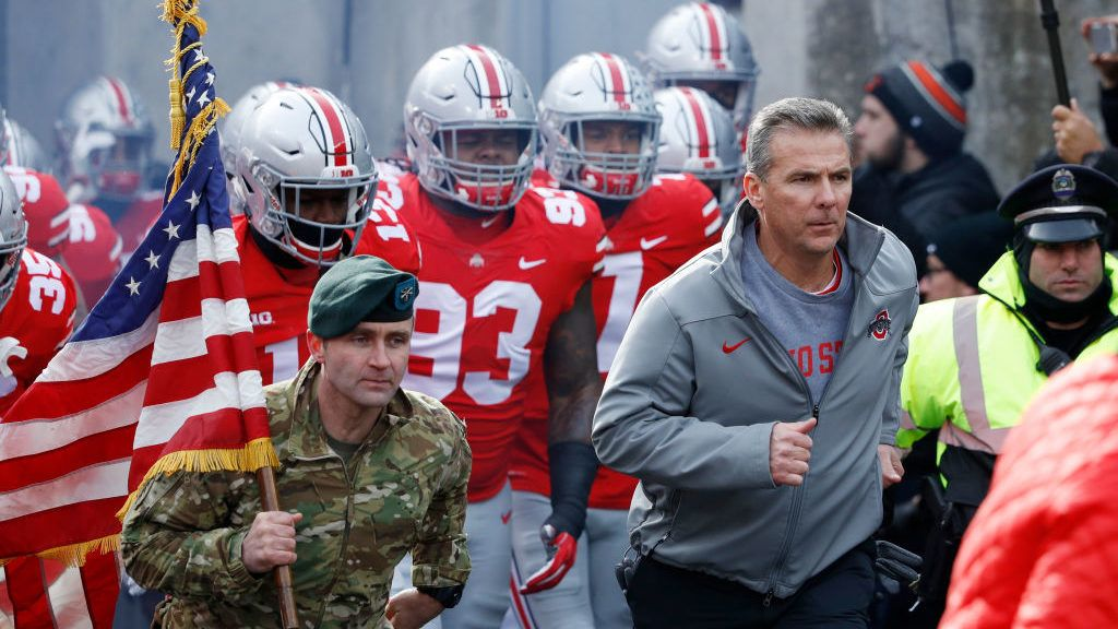 COLUMBUS, OH - NOVEMBER 11: Head coach Urban Meyer of the Ohio State Buckeyes leads his team to the field before a game against the Michigan State Spartans at Ohio Stadium on November 11, 2017 in Columbus, Ohio. Ohio State won 48-3. (Photo by Joe Robbins/Getty Images)