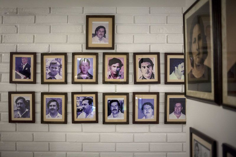 Photographs of narcotics kingpinPablo Escobar hang on display at the Casa Museo Pablo Escobar in Medellin, Colombia, on Tuesday, Oct. 3, 2017. In Colombia, where more than 200,000 people have died in conflict over the past half-century, residents find the boom in narco-tourism upsetting. Photographer: Fabiola Ferrero/Bloomberg via Getty Images