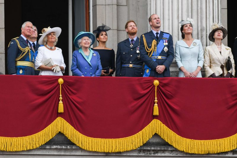LONDON,  UNITED KINGDOM - JULY 1O:   Prince Charles, Prince of Wales, Camilla, Duchess of Cornwall, Queen Elizabeth ll, Meghan, Duchess of Sussex, Prince Harry, Duke of Sussex, Prince William, Duke of Cambridge, Catherine, Duchess of Cambridge and Princess Anne, Princess Royal stand on the balcony of Buckingham Palace to view a flypast to mark the centenary of the Royal Air Force (RAF)  on July 10, 2018 in London, England. (Photo by Anwar Hussein/WireImage)