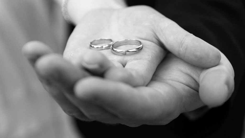 two wedding rings in hands