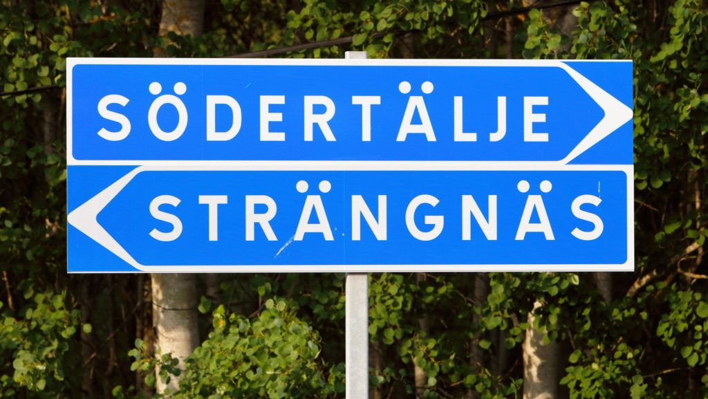 Signpost with direction to the two Swedish citys Sodertalje and Strangnas.