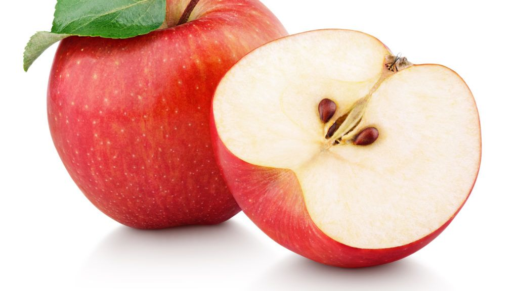 Ripe red apple fruit with apple half and green apple leaf isolated on white background. Apples and leaf with clipping path