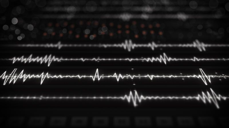 Digital audio waves on screen. Computer generated image rendered with DOF
