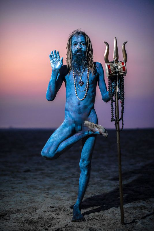 Aghori guru. LOOKING remarkably like a character from the academy award-winning 2009 film incredible images from a new book have revealed what could be the last Avatar-like human. Stunning shots show a guru from the Aghori with a bluish grey colouring to his skin, often created by smearing human cremation ashes from funerals on their bodies. Other striking pictures show different tribes throughout India including Rabari from Rajasthan, Kshatriyas of Kumaun from Uttrakhand and the Konyak Tribe from Nagaland. The remarkable photographs form part of Indian photographer Aman Chotani's project, The Last Avatar, a book documenting Indian tribes and culture before they vanish forever. Aman Chotani / mediadrumimages.com ***EXCLUSIVE***