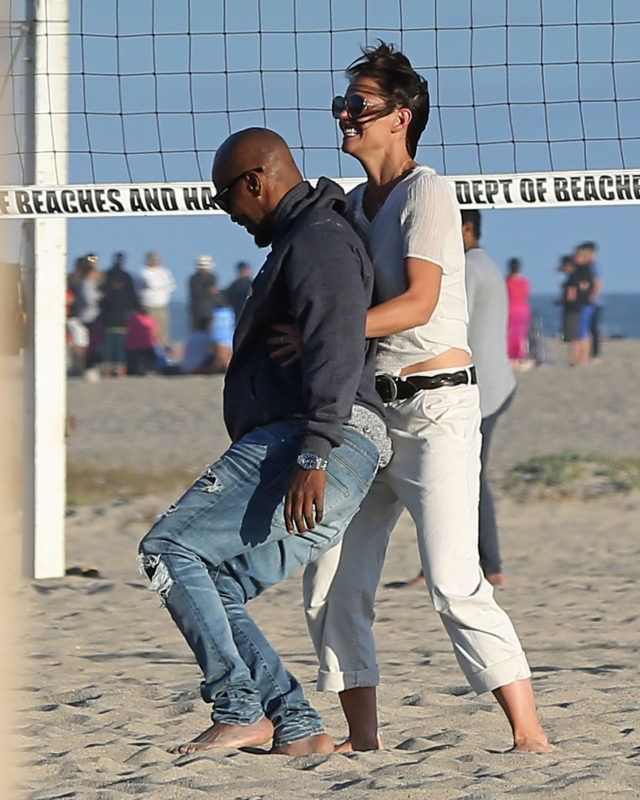 ** PREMIUM EXCLUSIVE ** STRICTLY NO WEB UNTIL 645PM BST 4TH AUGUST ** Katie Holmes and Jamie Foxx show they're still very much head over heals in love as they frolic on the beach almost a year after being seen in public for the first time. The amazing pictures show the loved-up Hollywood couple kissing and cuddling during a romantic summer date in front of dozens of other beach-goers. The notoriously private duo couldn't hide their affections for each other as they smooched while lying on a blanket in the sand before playing volleyball and a game of beach tennis. And Katie collapsed on the sand in laughter after attempting to bend backwards over Jamie's outstretched arms. The couple - who have been linked together since 2013 - looked like they didn't have a care in the world as they frolicked and wrestled with each other in front of onlookers in Malibu, California. And the romance has clearly put a smile on the face of Katie, 39, who was seen literally doing a cartwheel while laughing. Katie looked beach casual in a white t-shirt and cream pants while Jamie, 50, rocked a pair of blue denim jeans and a gray hooded sweatshirt. The pair have been linked since a year after Katie ended her six year marriage to Mission Impossible star Tom Cruise. The very private couple have reportedly been dating since being spotted dancing together at the Hamptons a year after the Dawson Creek star's highly-publicised separation from Cruise. They have taken extraordinary measures to keep their relationship secret amid claims Katie's ex-husband included a clause in her 2012 divorce settlement banning her from publicly dating for five years. The actress split from Top Gun superstar in 2012 after six years. Their romance was one the Hollywood's biggest headline makers after they got engaged in 2005 after just seven weeks of dating. 02 Aug 2018 Pictured: Katie Holmes Jamie Foxx. Photo credit: P&P/MEGA TheMegaAgency.com +1 888 505 6342 August 2, 2018