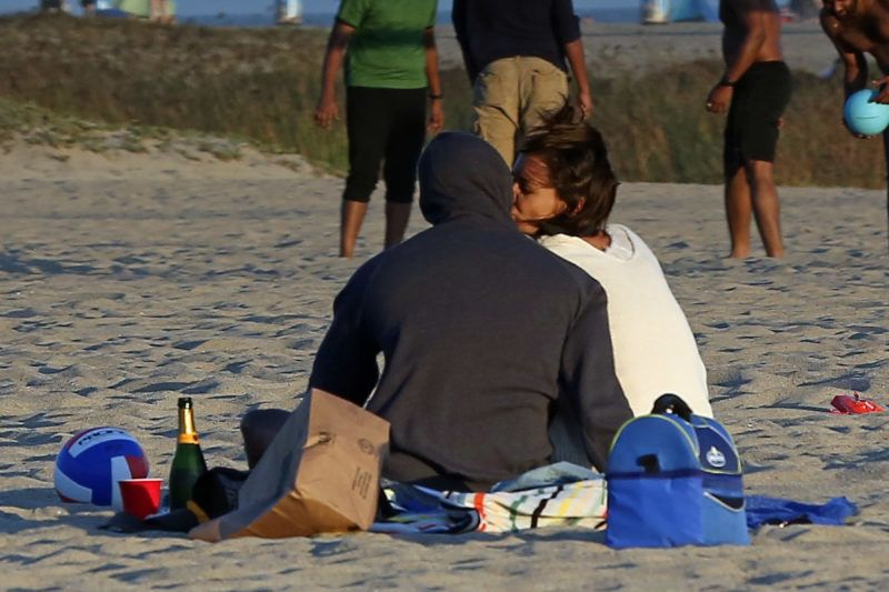 ** PREMIUM EXCLUSIVE ** STRICTLY NO WEB UNTIL 645PM BST 4TH AUGUST **  Katie Holmes and Jamie Foxx show they re still very much head over heals in love as they frolic on the beach almost a year after being seen in public for the first time. The amazing pictures show the loved-up Hollywood couple kissing and cuddling during a romantic summer date in front of dozens of other beach-goers. The notoriously private duo couldn t hide their affections for each other as they smooched while lying on a blanket in the sand before playing volleyball and a game of beach tennis. And Katie collapsed on the sand in laughter after attempting to bend backwards over Jamie s outstretched arms. The couple - who have been linked together since 2013 - looked like they didn t have a care in the world as they frolicked and wrestled with each other in front of onlookers in Malibu, California. And the romance has clearly put a smile on the face of Katie, 39, who was seen literally doing a cartwheel while laughing. Katie looked beach casual in a white t-shirt and cream pants while Jamie, 50, rocked a pair of blue denim jeans and a gray hooded sweatshirt. The pair have been linked since a year after Katie ended her six year marriage to Mission Impossible star Tom Cruise. The very private couple have reportedly been dating since being spotted dancing together at the Hamptons a year after the Dawson Creek star's highly-publicised separation from Cruise. They have taken extraordinary measures to keep their relationship secret amid claims Katie's ex-husband included a clause in her 2012 divorce settlement banning her from publicly dating for five years. The actress split from Top Gun superstar in 2012 after six years. Their romance was one the Hollywood's biggest headline makers after they got engaged in 2005 after just seven weeks of dating. 02 Aug 2018 Pictured: Katie Holmes Jamie Foxx. Photo credit: P&P/MEGA  TheMegaAgency.com +1 888 505 6342 August 2, 2018 *** Local Caption *** MEGA255806_020