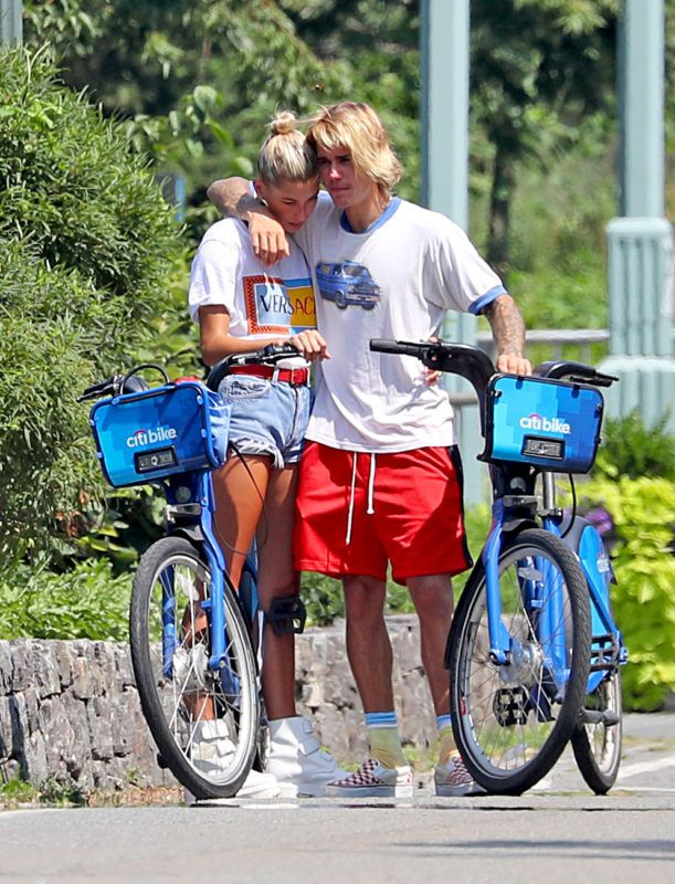 EXCLUSIVE: Justin Bieber seemed visibly upset today as he and fiance, Hailey Baldwin rode Citibikes up the West Side of Manhattan. Hailey did her best to comfort Justin, and at one point their heads were touch for so long that it seemed as if the newly engaged couple might have been praying. Whatever it was, it seems to have worked because the pair eventually git back on their bikes and rode away with smiles on their faces. 07 Aug 2018 Pictured: Justin Bieber, Hailey Baldwin. Photo credit: MEGA  TheMegaAgency.com +1 888 505 6342 August 7, 2018 *** Local Caption *** MEGA260623_004