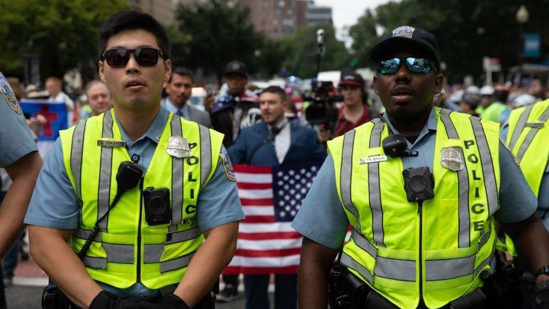 "WASHINGTON, USA - AUGUST 12: Security officials stand guard as right wing extremists stage a demonstration, named ""Unite The Right 2"" rally, for the one-year anniversary of the deadly far-right protests, which costed a young woman's life in Charlottesville, as they march to the Lafayette Square in Washington, United States on August 12, 2018. Yasin Ozturk / Anadolu Agency"