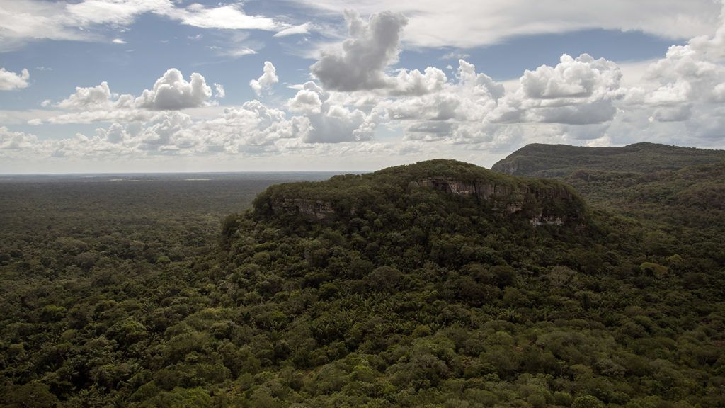 View of the Cerro Azul, in the Serrania La Lindosa -which had been declared Protected Archaeological Site of Colombia last May- in the Amazonian jungle department of Guaviare, Colombia, on July 2, 2018. Both the Serranias of Chiribiquete and La Lindosa had been closed to outsiders for many years during the armed conflict and are now opening up to scientific research.  / AFP PHOTO / Diana Sanchez