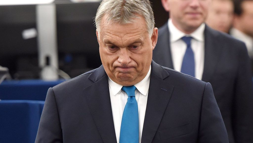 Hungary's Prime Minister Viktor Orban reacts upon his arrival ahead of a debate concerning Hungary's situation during a plenary session  at the European Parliament on September 11, 2018 in Strasbourg, eastern France. / AFP PHOTO / FREDERICK FLORIN