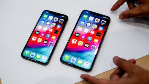An Apple iPhone Xs Max (R) and iPhone Xs rest on a table during a launch event on September 12, 2018, in Cupertino, California. New iPhones set to be unveiled Wednesday offer Apple a chance for fresh momentum in a sputtering smartphone market as the California tech giant moves into new products and services to diversify.Apple was expected to introduce three new iPhone models at its media event at its Cupertino campus, notably seeking to strengthen its position in the premium smartphone market a year after launching its $1,000 iPhone X.  / AFP PHOTO / NOAH BERGER