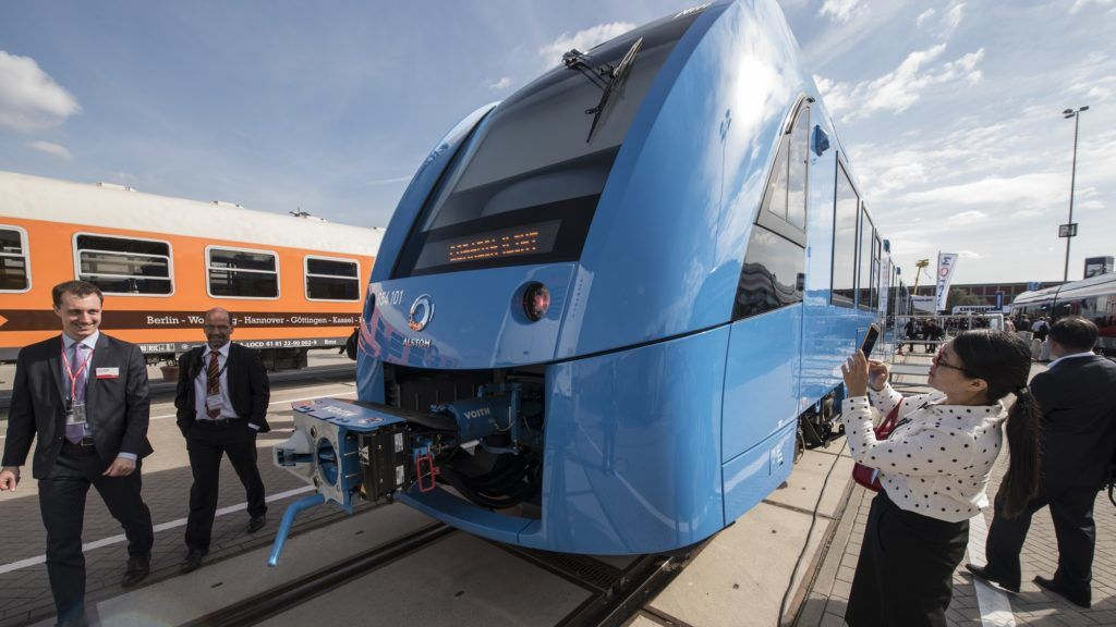 Visitors check out the Coradia iLint train, a CO2-emission-free regional train developed by French transport giant Alstom, after it was unveiled at Innotrans, the railway industry's largest trade fair, in Berlin on September 20, 2016. InnoTrans takes place from 20 to 23 September 2016.  / AFP PHOTO / John MACDOUGALL