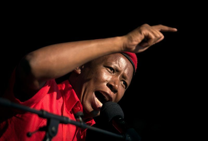 Leader of the South African radical-left opposition party Economic Freedom Fighters (EFF), Julius Malema delivers a speech during a mass rally marking the party's fourth anniversary on July 29, 2017 at the Curries Fountain Stadium in Durban.  / AFP PHOTO / RAJESH JANTILAL