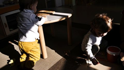 Children play in the nursery of Bollate Penitentiary, on October 12, 2017 in Milan.The prison hosts a nursery for children of female inmates, of employees, but also children from families living in the neighborhood. The nursery also organize animations for children with horses and a dog.The asylum structure is an initiative of the prison jail and lies within the perimeter of the prison. The service is provided by the Biobab Association. / AFP PHOTO / MARCO BERTORELLO