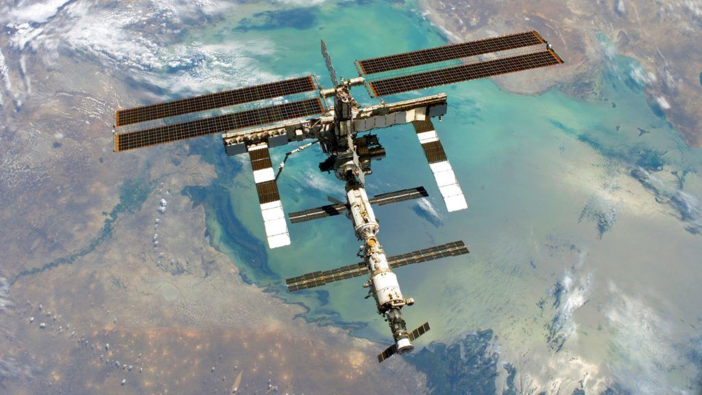 Photograph of the International Space Station; photo taken from shuttle Discovery. Dated 2005