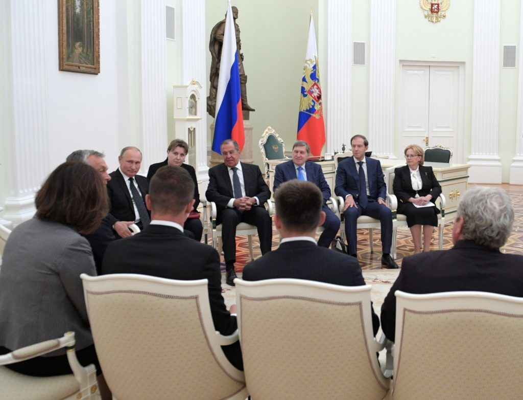 5640259 18.09.2018 September 18, 2018. Russian President Vladimir Putin during a meeting with Hungarian Prime Minister Viktor Orban. Background, from right: Russian Healthcare Minister Veronika Skvortsova, Minister of Industry and Trade Denis Manturov, Presidential Aide Yury Ushakov and Foreign Minister Sergei Lavrov. Alexei Druzhinin / Sputnik