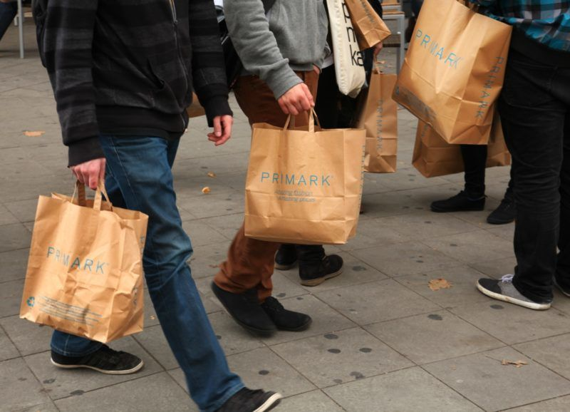 Young people carry Primark bags of brown paper in Berlin, September 27, 2013. Photo: Wolfram Steinberg dpa