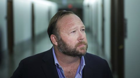 WASHINGTON, DC - SEPTEMBER 5: Alex Jones of InfoWars talks to reporters outside a Senate Intelligence Committee hearing concerning foreign influence operations' use of social media platforms, on Capitol Hill, September 5, 2018 in Washington, DC. Twitter CEO Jack Dorsey and Facebook chief operating officer Sheryl Sandberg faced questions about how foreign operatives use their platforms in attempts to influence and manipulate public opinion.   Drew Angerer/Getty Images/AFP