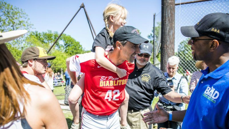 AUSTIN, TX - APRIL 14: Rep. Beto O'Rourke (D-TX) carries his daughter Molly during a fundraiser baseball game on April 14, 2018 in Austin, Texas. O'Rourke is an El Paso Democrat looking to unseat Sen. Ted Cruz (R-TX) in the 2018 election.   Drew Anthony Smith/Getty Images/AFP