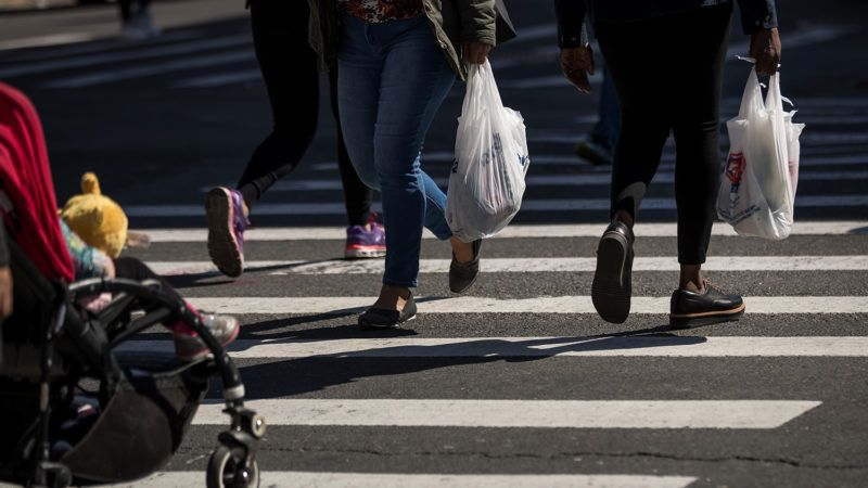 NEW YORK, NY - APRIL 23: Pedestrians carry plastic shopping bags across Atlantic Avenue, April 23, 2018 in the Brooklyn borough of New York City. New York Governor Andrew Cuomo introduced on Monday a bill that proposes to ban single-use carryout plastic bags statewide. If passed, the new law would go in effect in January of 2019.   Drew Angerer/Getty Images/AFP