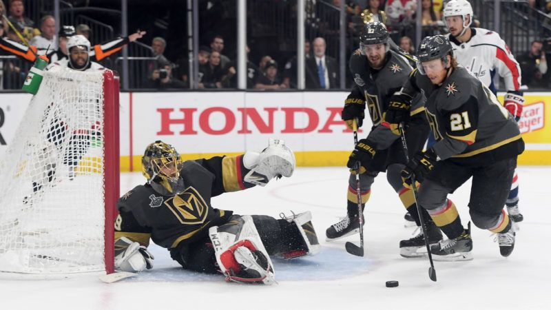LAS VEGAS, NV - JUNE 07: Cody Eakin #21 of the Vegas Golden Knights carries the puck away from Marc-Andre Fleury #29 against the Washington Capitals during the second period in Game Five of the 2018 NHL Stanley Cup Final at T-Mobile Arena on June 7, 2018 in Las Vegas, Nevada.   Harry How/Getty Images/AFP
