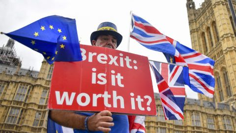 Demonstrtors gather outside the Parliament to protest against Brexit, waving EU and Union flags and a placard reading 'Brexit Is It Worth It?', London on September 12, 2018. Conservatives MPs opposed to Mrs May's Brexit Plan have met to discuss how and when they could force her to stand down as Prime Minister. (Photo by Alberto Pezzali/NurPhoto)
