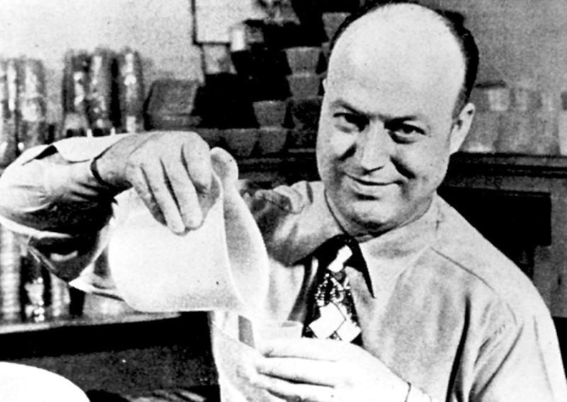 Earl Silas Tupper, inventor of Tupperware, holds one of his original designs.