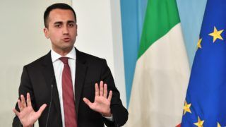 """Italy's Labor and Industry Minister and deputy PM Luigi Di Maio, answers to journalists during a press conference on the theme """"Dignity Decree"""", after the approval of the Council of Ministers held yesterday, at Palazzo Chigi in Rome on July 3, 2018.    / AFP PHOTO / Andreas SOLARO"""